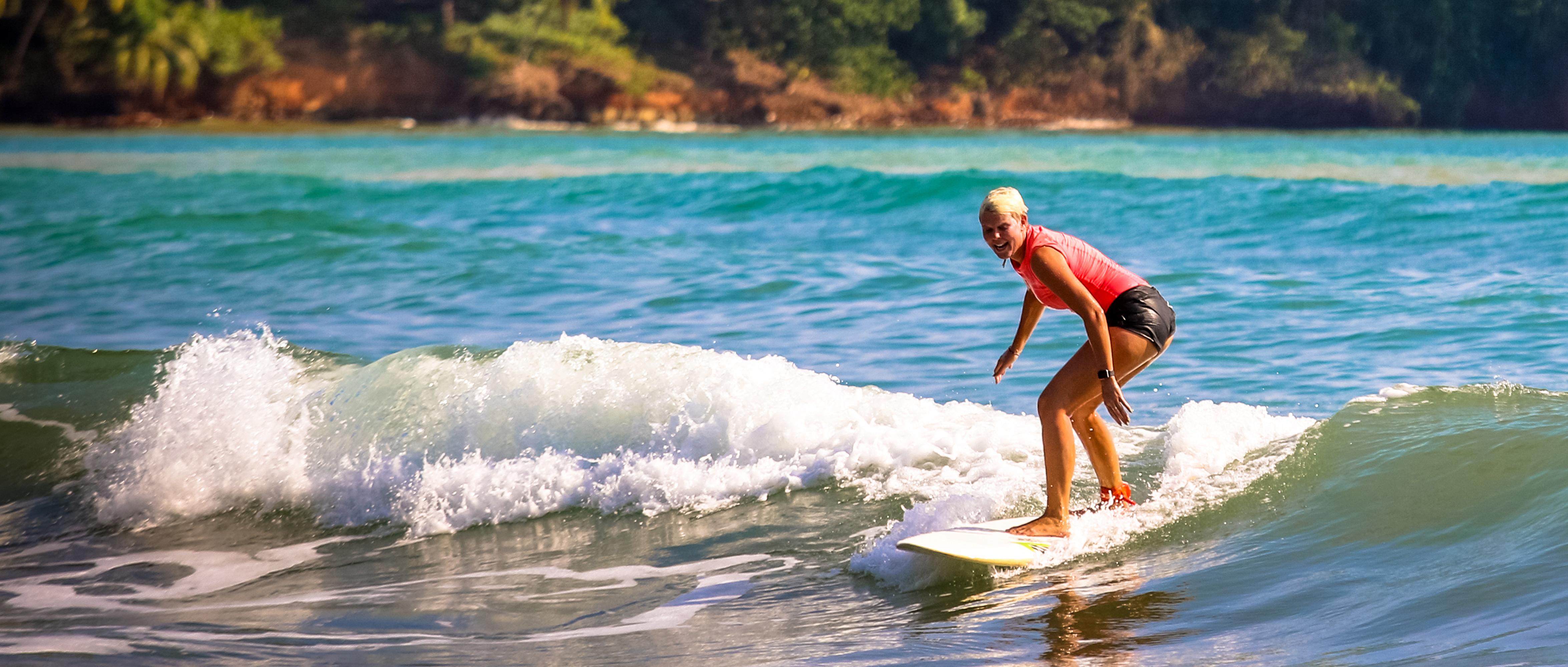 Surfer Riding a Wave: Altos de Miramar, Dominical, Osa Peninsula