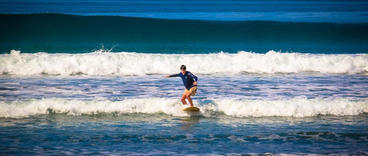 teen surfing in costa rica