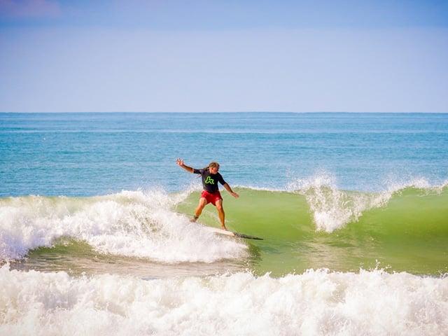 teen surfing in costa rica water