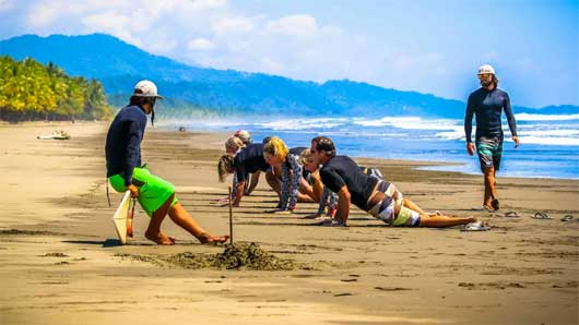 surf practice on the beach in costa rica